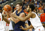 Notre Dame forward Nate Laszewski, left, tries to grab a rebound in front of Virginia guard Braxton Key, right, during the first half of an NCAA college basketball game in Charlottesville, Va., Saturday, Feb. 16, 2019. (AP Photo/Steve Helber)