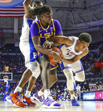 LSU forward Naz Reid (0) and Florida forward Keyontae Johnson (11) vie for possession of the ball during the second half of an NCAA college basketball game in Gainesville, Fla., Wednesday, March 6, 2019. A jump ball was called. (AP Photo/Gary McCullough)