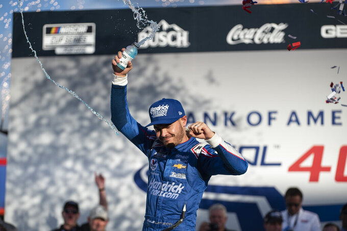 Kyle Larson (5) celebrates in Victory Lane after a NASCAR Cup Series auto racing race at Charlotte Motor Speedway, Monday, Oct. 11, 2021, in Concord, N.C. (AP Photo/Matt Kelley)