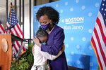Former Boston City Council President Kim Janey, 55, hugs her granddaughter, Rosie, after she was sworn in as Boston's new mayor at City Hall, Wednesday, March 24, 2021, in Boston. Janey, who is the city's first female and first person of color to take the office, replaces Marty Walsh who resigned Monday evening to become President Joe Biden's labor secretary. (AP Photo/Elise Amendola)