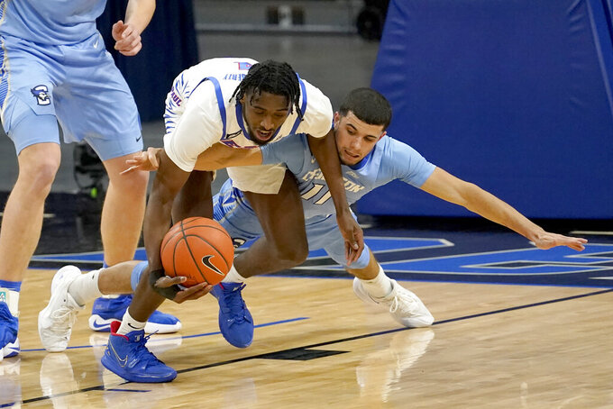 Creighton's Marcus Zegarowski (11) battles DePaul's Javon Freeman-Liberty for the ball during the first half of an NCAA college basketball game Saturday, Jan. 30, 2021, in Chicago. (AP Photo/Charles Rex Arbogast)