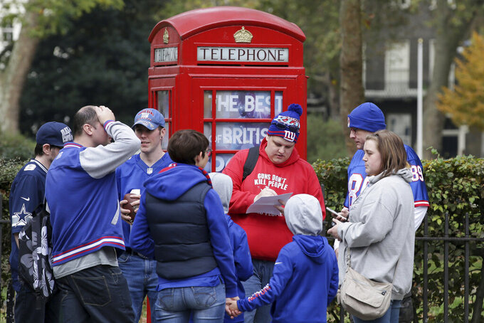 FILE - In this Oct. 22, 2016, file photo, fans wait outside before an NFL Fan Rally at the NFL House in Victoria House, in London. The Los Angeles Rams were in town to play the New York Giants at Twickenham stadium in London. As the league celebrates its 100th season, it continues to expand its foreign footprint with five international games in 2019. Four are in London, including two at Wembley Stadium, and the league returns to Mexico. (AP Photo/Tim Ireland, File)