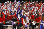 Kansas State's Nijel Pack (24) reacts after a three-point play during the first half of an NCAA college basketball game against Texas Tech, Tuesday, Jan. 5, 2021, in Lubbock, Texas. (AP Photo/Brad Tollefson)