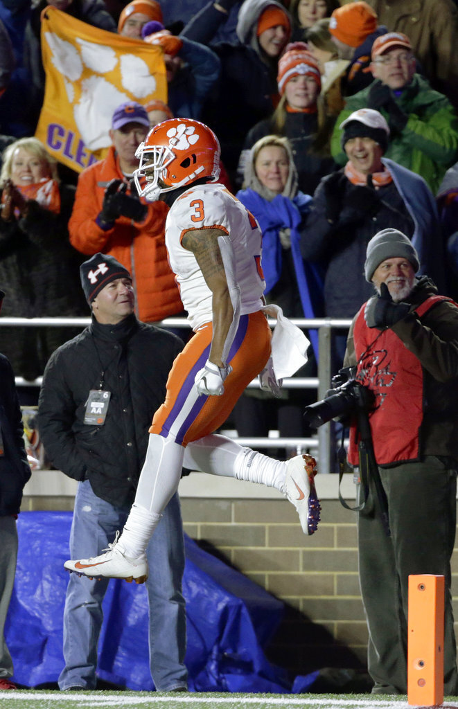 Clemson's Amari Rodgers leaps to celebrate his punt return for a touchdown against Boston College during the second half of an NCAA college football game, Saturday, Nov. 10, 2018, in Boston. (AP Photo/Elise Amendola)