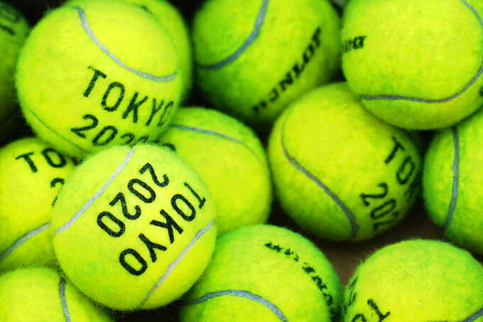 Tennis balls that are used for practice sit at the Ariake Tennis Center ahead of the 2020 Summer Olympics, Thursday, July 22, 2021, in Tokyo, Japan. (AP Photo/Seth Wenig)