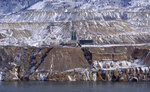 FILE - In this Dec. 14, 2016, file photo, the Horseshoe Bend Treatment Plant is seen at the far shore of the Berkeley Pit in Butte, Mont. U.S. Environmental Protection Agency Acting Administrator David Wheeler planned to visit Butte, Friday, Sept. 7, 2018, after an estimated 3,000 snow geese died when they landed in the pit in 2016. (AP Photo/Matt Volz, File)