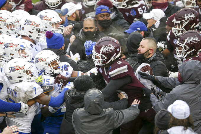 Tulsa cornerback Reggie Ellis (15) and Mississippi State linebacker Aaron Brule (3) exchange blows during a postgame fight after Mississippi State's win in the Armed Forces Bowl NCAA college football game in Fort Worth, Texas, Thursday, Dec. 31, 2020. (Ian Maule/Tulsa World via AP)