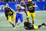 Florida running back Jordan Scarlett (25) runs against Michigan during the second half of the Peach Bowl NCAA college football game, Saturday, Dec. 29, 2018, in Atlanta. Florida won 41-15. (AP Photo/Mike Stewart)