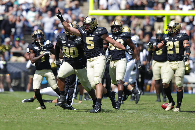 Purdue defensive end George Karlaftis (5) celebrates a Purdue defensive stop against Vanderbilt during the second half of an NCAA college football game in West Lafayette, Ind., Saturday, Sept. 7, 2019. Purdue defeated Vanderbilt 42-24. (AP Photo/Michael Conroy)