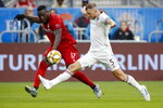 Toronto FC forward Jozy Altidore (17) and Colorado Rapids defender Tommy Smith (5) vie for the ball in the first half of MLS soccer action at BMO Field in Toronto, Sunday, Sept. 15 2019. (Cole Burston/The Canadian Press via AP)
