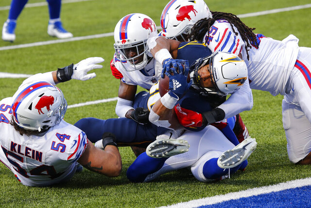 Los Angeles Chargers running back Austin Ekeler (30) is tackled by Buffalo Bills middle linebacker Tremaine Edmunds (49) during the second half of an NFL football game, Sunday, Nov. 29, 2020, in Orchard Park, N.Y. (AP Photo/Jeffrey T. Barnes)