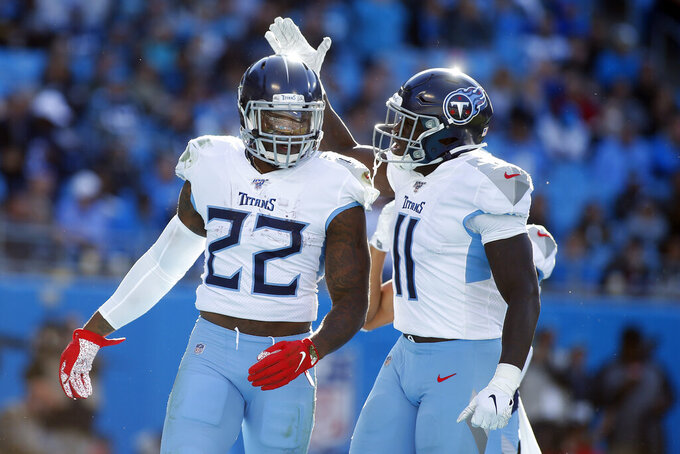 Tennessee Titans wide receiver A.J. Brown (11) congratulates running back Derrick Henry (22) following Henry's touchdown against the Carolina Panthers during the second half of an NFL football game in Charlotte, N.C., Sunday, Nov. 3, 2019. (AP Photo/Brian Blanco)