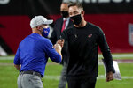 Arizona Cardinals head coach Kliff Kingsbury, right, greets Buffalo Bills head coach Sean McDermott after an NFL football game, Sunday, Nov. 15, 2020, in Glendale, Ariz. The Cardinals won 32-20. (AP Photo/Rick Scuteri)