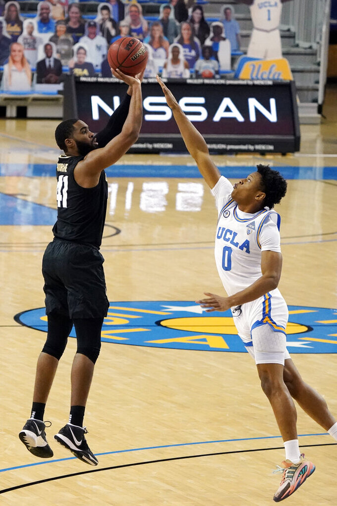 Colorado forward Jeriah Horne (41) shoots over UCLA guard Jaylen Clark (0) during the first half of an NCAA college basketball game Saturday, Jan. 2, 2021, in Los Angeles. (AP Photo/Marcio Jose Sanchez)