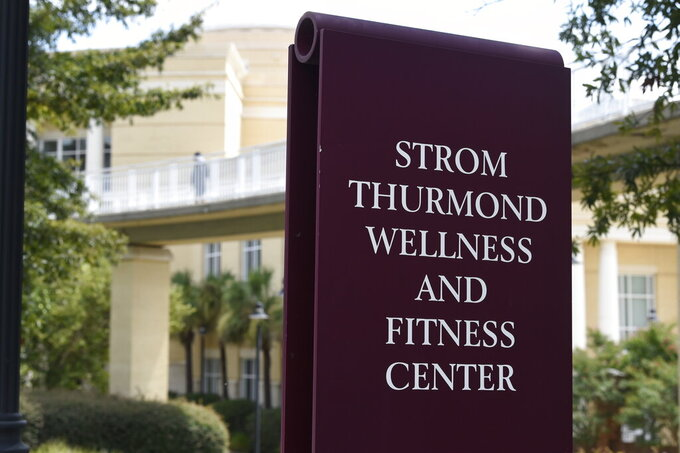 A sign advertises the Strom Thurmond Wellness and Fitness Center on Thursday, Aug. 20, 2020, in Columbia, S.C. Some of the University of South Carolina's most prominent recent athletes are calling for the renaming of the $38.6 million complex, arguing that its namesake shouldn't be glorified for his segregationist views. (AP Photo/Meg Kinnard)