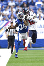 Houston Texans' Kenny Stills (12) makes a catch against Indianapolis Colts' Rock Ya-Sin (34) during the second half of an NFL football game, Sunday, Oct. 20, 2019, in Indianapolis. (AP Photo/Doug McSchooler)