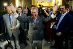 FILE - In this Friday, June 24, 2016 file photo Nigel Farage, the leader of the UK Independence Party, celebrates and poses for photographers as he leaves a