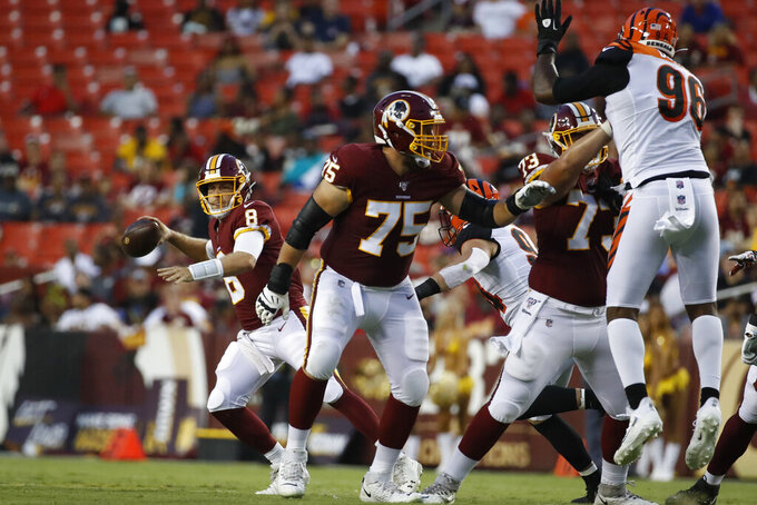 Washington Redskins quarterback Case Keenum (8) looks to pass with protection from offensive guard Brandon Scherff (75) during the first half of the team's NFL preseason football game against the Cincinnati Bengals, Thursday, Aug. 15, 2019, in Landover, Md. (AP Photo/Alex Brandon)