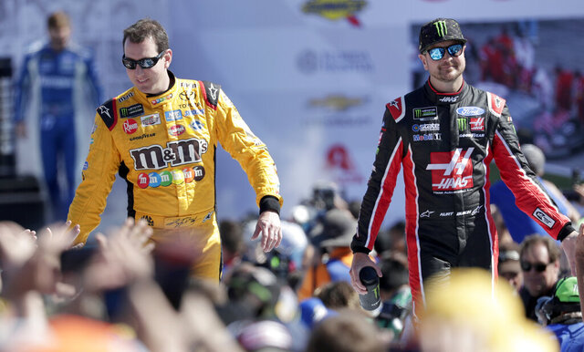 FILE - In this Feb. 18, 2018, file photo, Kyle Busch, left, and Kurt Busch, right, greet fans as they are introduced before a NASCAR Daytona 500 Cup Series auto race at Daytona International Speedway in Daytona Beach, Fla. The Busch family hobby came full circle at Las Vegas Motor Speedway, where Kurt finally won for the first time in his career Sunday, Sept. 27, 2020. The victory came about 24 hours after his nephew, Brexton Busch, won his first race at a track in North Carolina. The 5-year-old son of reigning Cup champion Kyle is being developed by Tom Busch, who molded his own two sons into NASCAR champions. (AP Photo/John Raoux, File)
