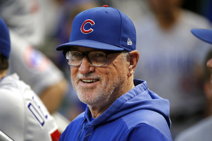 FILE - In this Sept. 25, 2019, file photo, then-Chicago Cubs manager Joe Maddon stands in the dugout before a baseball game against the Pittsburgh Pirates, in Pittsburgh. Joe Maddon has agreed to become the Los Angeles Angels' manager. Maddon and the Angels agreed to terms Wednesday, Oct. 16, 2019, on a deal to reunite the veteran manager with the organization where he spent the first three decades of his baseball career. (AP Photo/Gene J. Puskar, File)