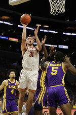 Southern California forward Nick Rakocevic (31) scores against LSU during the first half of an NCAA college basketball game Saturday, Dec. 21, 2019, in Los Angeles. (AP Photo/Marcio Jose Sanchez)