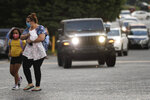 Students arrive to Dallas Elementary School for the first day of school amid the coronavirus outbreak on Monday, Aug. 3, 2020, in Dallas, Ga. (AP Photo/Brynn Anderson)
