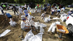 Resident fill sandbags Friday, July 12, 2019, in Baton Rouge, La., ahead of Tropical Storm Barry.  The National Weather Service in New Orleans says water is already starting to cover some low lying roads in coastal Louisiana as Tropical Storm Barry approaches the state from the Gulf of Mexico. (AP Photo/David J. Phillip)