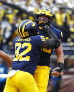 Michigan fullback Ben Mason celebrates his one-yard touchdown run with Nick Eubanks (82) in the first half of an NCAA football game against Maryland in Ann Arbor, Mich., Saturday, Oct. 6, 2018. (AP Photo/Paul Sancya)