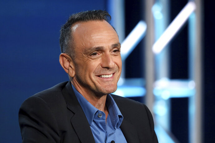 """FILE - In this Jan. 16, 2020 file photo, Hank Azaria speaks during the AMC Networks TCA 2020 Winter Press Tour in Pasadena, Calif. Azaria told the industry blog, slashfilm.com, that he has no plans to continue voicing his character of Apu on """"The Simpsons."""" But that isn't to say the Indian immigrant convenience store owner Azaria brought alive for 30 years won't live on. Producers and Fox Broadcasting Co. wouldn't confirm to The Associated Press Azaria's exit or an end to Apu, a recurring character that has drawn criticism for reinforcing racial stereotypes. There was no immediate reply Saturday, Jan. 18 from Azaria's publicist. (Photo by Willy Sanjuan/Invision/AP)"""