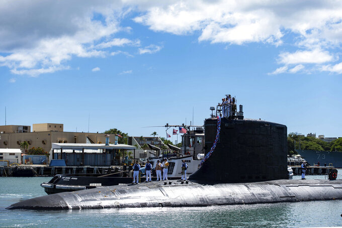 In this photo provided by U.S. Navy, the Virginia-class fast-attack submarine USS Illinois (SSN 786) returns home to Joint Base Pearl Harbor-Hickam from a deployment in the 7th Fleet area of responsibility on Sept. 13, 2021.Australia decided to invest in U.S. nuclear-powered submarines and dump its contract with France to build diesel-electric submarines because of a changed strategic environment, Prime Minister Scott Morrison said on Thursday, Sept. 16, 2021. (Mass Communication Specialist 1st Class Michael B. Zingaro/U.S. Navy via AP)