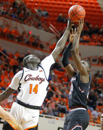 Oklahoma State's Yor Anei (14) blocks the shot of South Carolina's Keyshawn Bryant (24) during an NCAA college basketball game in Stillwater, Okla., Saturday, Jan. 26, 2019.(Bryan Terry/The Oklahoman via AP)