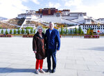 FILE - In this file photo taken May 22, 2019, and released by the U.S. Embassy in Beijing, U.S. Ambassador to China Terry Branstad and his wife Christine pose for a photo in front of the Potala Palace in Lhasa in western China's Tibet Autonomous Region. China said Wednesday, Jul 8, 2020, it will impose visa restrictions on U.S. individuals following the Trump administration's imposition of travel bans on Chinese officials it accuses of restricting foreigners' access to Tibet. (U.S. Mission to China via AP, File)