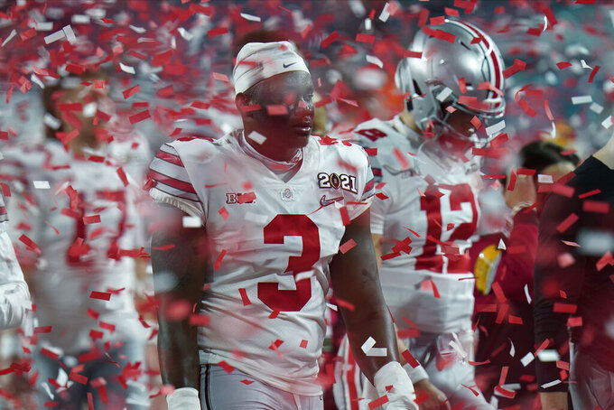 Ohio State players leave the field after their loss to Alabama in an NCAA College Football Playoff national championship game, Monday, Jan. 11, 2021, in Miami Gardens, Fla. Alabama won 52-24. (AP Photo/Chris O'Meara)