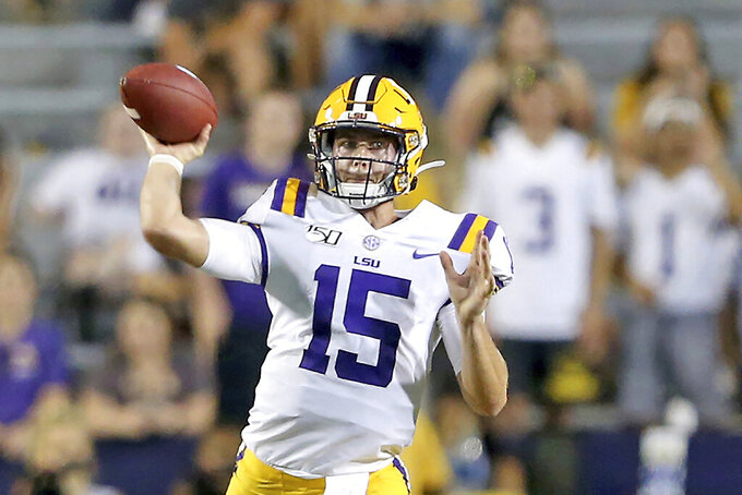 FILE - In this Saturday, Aug. 31, 2019, file photo, LSU Tigers quarterback Myles Brennan (15) passes during an NCAA football game against Georgia Southern in Baton Rouge, La. LSU enters Saturday's season opener with Myles Brennan taking over at quarterback for Heisman Trophy winner Joe Burrow while Mississippi State has a new coach in Mike Leach whose reputation for high-flying offenses precedes him. (AP Photo/Michael Democker, File)