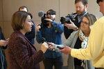 Democratic presidential candidate Sen. Amy Klobuchar, D-Minn., speaks to member of the media before heading back to the Capitol for the impeachment trial of President Donald Trump, Wednesday, Jan. 22, 2020 in Washington. (AP Photo/Pablo Martinez Monsivais)