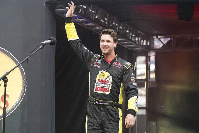 Josh Bilicki waves to fans before a NASCAR Cup Series auto race at Bristol Motor Speedway Saturday, Sept. 18, 2021, in Bristol, Tenn. (AP Photo/Mark Humphrey)