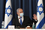 Israeli Prime Minister Benjamin Netanyahu wears a face mask to help prevent the spread of the coronavirus as he chairs the weekly cabinet meeting, at the foreign ministry, in Jerusalem, Sunday, July 5, 2020. (Photo by Gali Tibbon/Pool via AP)