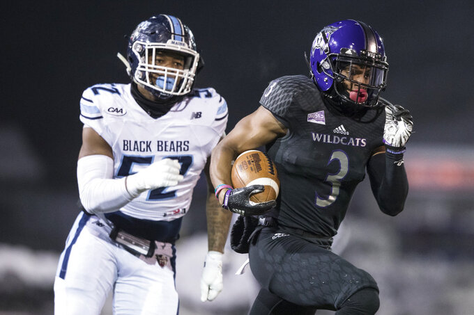 Weber State receiver Darryl Denby (3) runs the ball while pursued by Maine's Jamehl Wiley (52) during the first half of a quarterfinal in the NCAA Football Championship Subdivision playoffs Friday, Dec. 7, 2018, in Ogden, Utah. (Matt Herp/Standard-Examiner via AP)