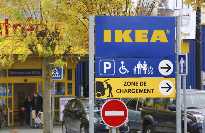 FILE - In this Wednesday, Nov. 30, 2013 file photo, customers leave an IKEA store in Plaisir, west of Paris. A French court has ordered home furnishings giant Ikea to pay more than $1.2 million in fines and damages Tuesday, June 15, 2021 over a campaign to spy on union representatives. (AP Photo/Remy de la Mauviniere, FIle)