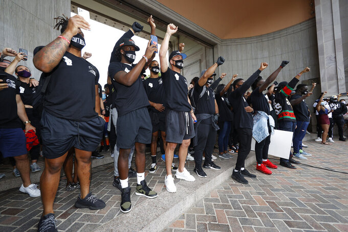Denver Broncos take part in a rally in the Greek Amphitheatre in Civic Center Park over the death of George Floyd Saturday, June 6, 2020, in downtown Denver. (AP Photo/David Zalubowski)