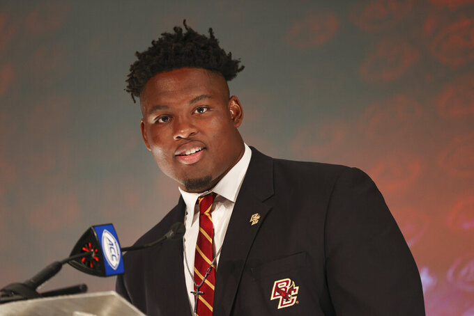 Boston College offensive lineman Zion Johnson answers a question during an NCAA college football news conference at the Atlantic Coast Conference media days in Charlotte, N.C., Thursday, July 22, 2021. (AP Photo/Nell Redmond)