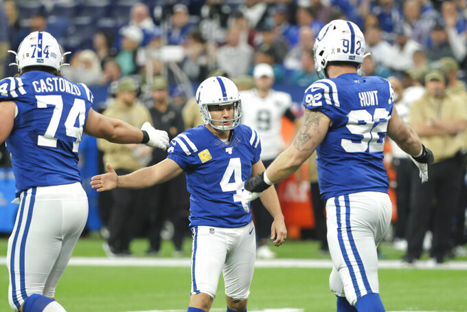 Indianapolis Colts kicker Adam Vinatieri (4) is congratulated by Anthony Castonzo (74) and Margus Hunt (92) after Vinatieri kicked a 34-yard field during the first half of an NFL football game against the Jacksonville Jaguars, Sunday, Nov. 17, 2019, in Indianapolis. (AP Photo/AJ Mast)