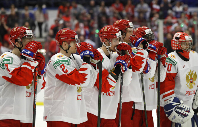 Russia's player stand on ice after loosing the U20 Ice Hockey Worlds gold medal match between Canada and Russia in Ostrava, Czech Republic, Sunday, Jan. 5, 2020. (AP Photo/Petr David Josek)