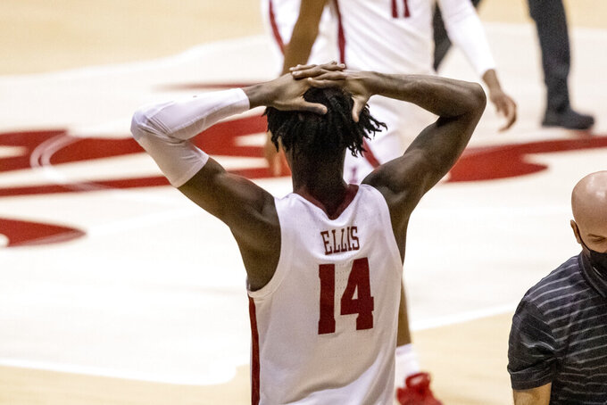 Alabama guard Keon Ellis (14) looks on after Alabama finished with a 73-71 loss to Western Kentucky after the second half of an NCAA college basketball game, Saturday, Dec. 19, 2020, in Tuscaloosa, Ala. (AP Photo/Vasha Hunt)