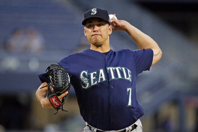 FILE - In this Sept. 17, 2019, file photo, Seattle Mariners starting pitcher Marco Gonzales delivers during the first inning of a baseball game against the Pittsburgh Pirates in Pittsburgh. The Mariners signed Gonzales to a $30 million, four-year contract Monday, Feb. 3, 2020, that includes a club option for the 2025 season. (AP Photo/Gene J. Puskar, File)