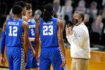 Kentucky head coach John Calipari talks to his players in the first half of an NCAA college basketball game between Kentucky and Vanderbilt Wednesday, Feb. 17, 2021, in Nashville, Tenn. (AP Photo/Mark Humphrey)