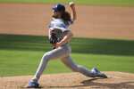Los Angeles Dodgers' relief pitcher Dustin May delivers a pitch against the San Diego Padres in the fifth inning of a baseball game Wednesday, Sept. 16, 2020, in San Diego. (AP Photo/Derrick Tuskan)