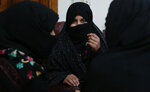 In this Monday, Feb. 18, 2019, photo, Alissa, who faced domestic violence, center, speaks during an interview with the Associated Press at a women's shelter office in Herat, Afghanistan. Women have made gains since the 2001 fall of the Taliban, but the country remains almost the worst places in the world to be a woman. Activists fear the advances they have achieved will be bargained away in negotiations, with pressure heavy for a deal as the United States seeks to end its military involvement in the country.(AP Photo/Rahmat Gul)