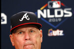 Atlanta Braves manager Brian Snitker (43) speaks to the media during a news conference Tuesday, Oct. 8, 2019, in Atlanta. The Braves will face the St. Louis Cardinals in Game 5 of the NLCS Wednesday in Atlanta. (AP Photo/John Bazemore)