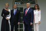 President Donald Trump and first lady Melania Trump stand for photographs with Polish President Andrzej Duda and his wife Agata Kornhauser-Duda outside the Oval Office of the White House, Wednesday, June 12, 2019, in Washington. (AP Photo/Evan Vucci)